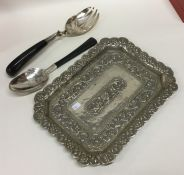 A Continental silver embossed dish together with m