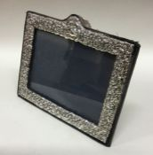 A rectangular chased silver picture frame. London.