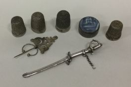 A bag containing a silver pill box, thimble etc. V