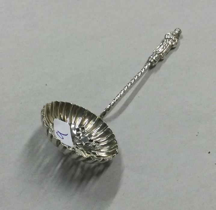 A silver Apostle top sifter spoon. Birmingham. App