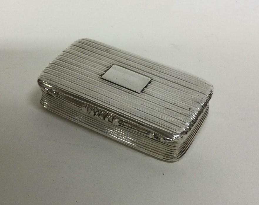 A George III silver reeded snuff box. Birmingham 1