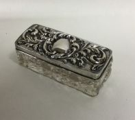An Edwardian silver mounted dressing table box wit