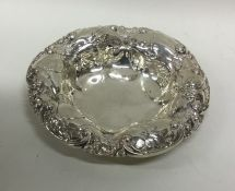 A Continental silver bonbon dish with scroll decor
