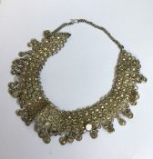A heavy Continental silver necklace with ball drop