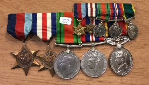 A bar of dress medals together with miniatures. Es