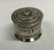An Asian silver box with lift-off cover. Approx. 8