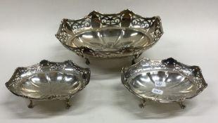 An Edwardian silver three piece sweet dish set wit