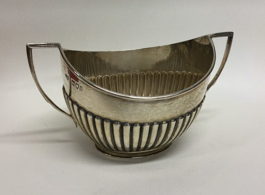 An Edwardian silver half fluted sugar bowl. London