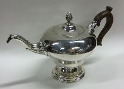 A good large George III silver teapot attractively