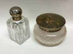 An Edwardian silver hinged top scent bottle togeth