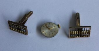 ROLEX: A small lady's watch movement together with
