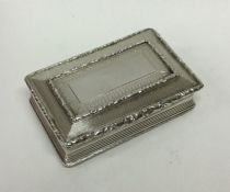 A heavy rectangular silver snuff box with hinged t
