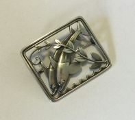 GEORG JENSEN. A rectangular silver brooch mounted