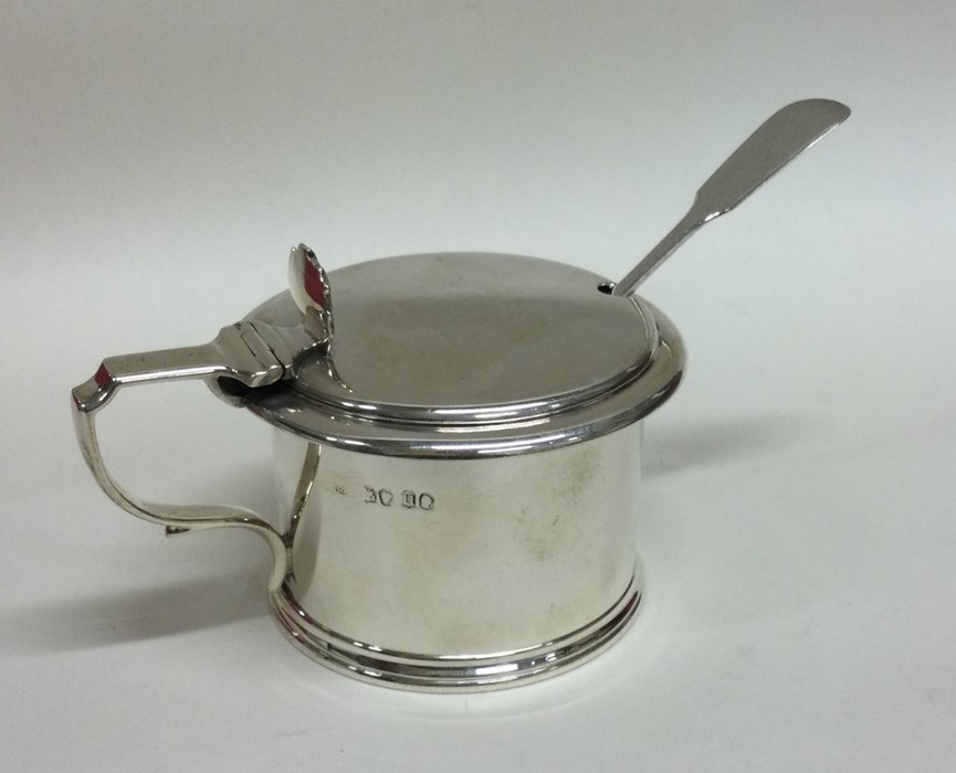 A good silver mustard pot with shell thumb piece.