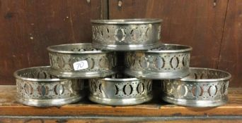 An unusual set of six silver plated coasters. Est.