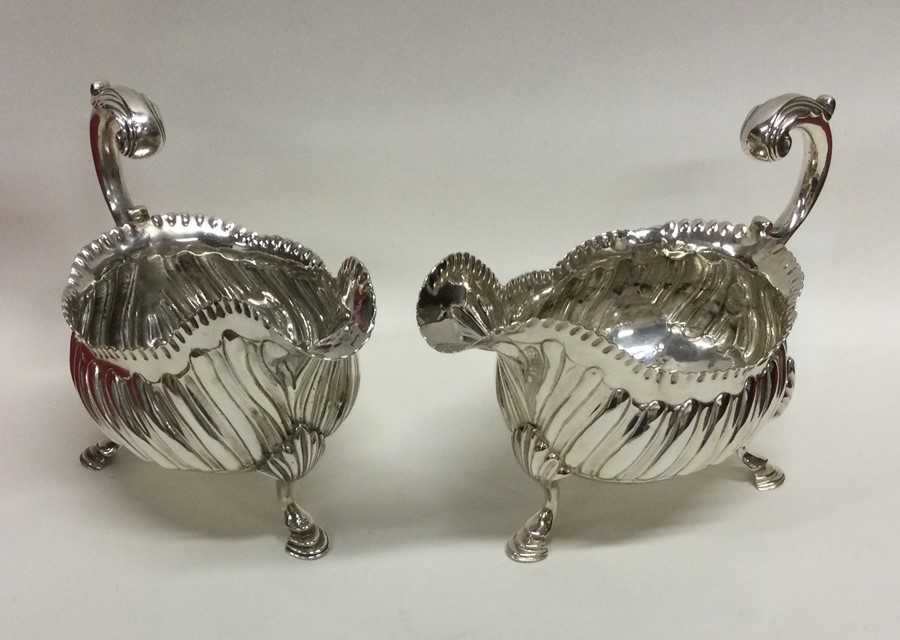 A good pair of heavy George III silver sauce boats