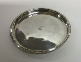 DUBLIN: A circular crested tray with reeded border