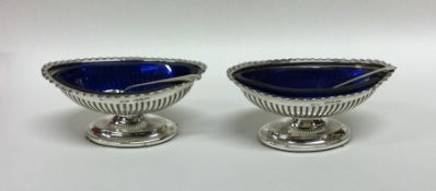 A pair of Edwardian silver salts together with spo