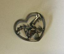 GEORG JENSEN. A stylish silver brooch in heart sha