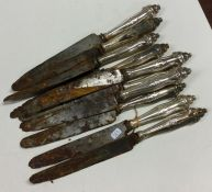 A heavy set of ten Continental silver knives with
