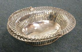 A large pierced George II silver basket on sweepin