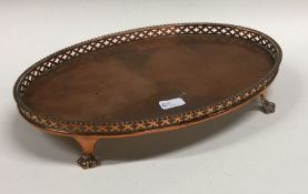 An old Sheffield plated salver with pierced rim. E