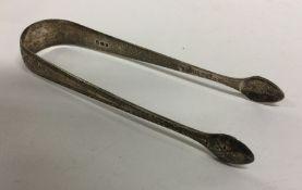 A pair of bright cut silver sugar tongs. London. A