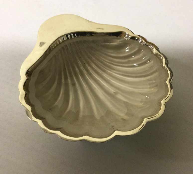 An Edwardian silver butter shell. Sheffield. By GH