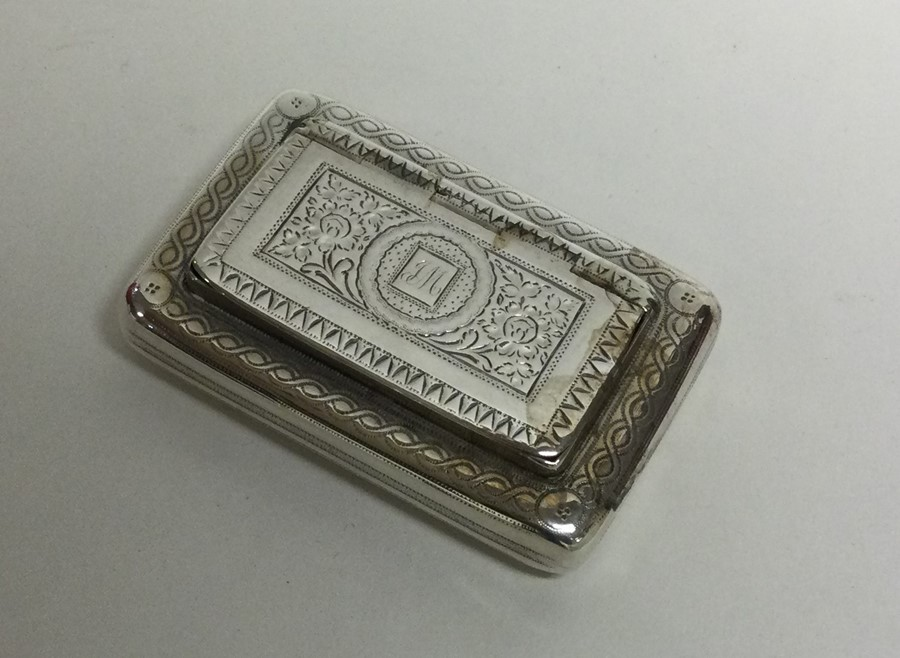 A George III bright cut silver snuff box with hing - Image 2 of 3
