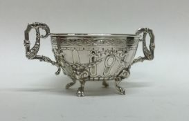 A good quality chased silver basket bearing import