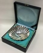 A large Japanese silver dish of shaped form. 950 s