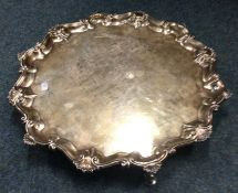 A large Georgian silver salver with shell border.