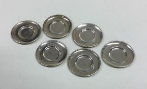 A set of six miniature silver dinner plates with s