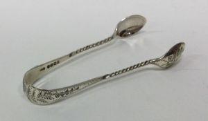 A pair of Victorian silver sugar tongs. Birmingham