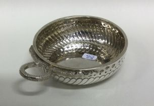 A large silver wine taster with serpent handle. Ci