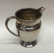 A heavy Edwardian silver cream jug. Birmingham. By