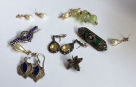 A pair of gold mounted earrings together with othe