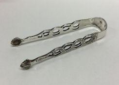 DUBLIN: A good pair of cast silver sugar tongs. By