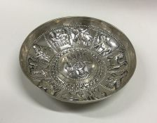 An unusual Greek silver dish decorated with animal