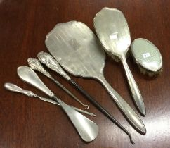 A collection of silver mounted dressing table item