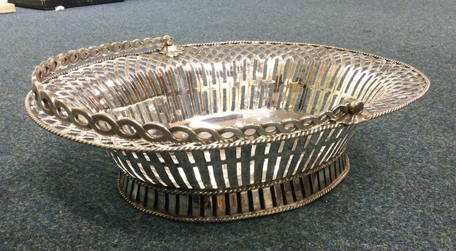 A large pierced George II silver basket on sweepin - Image 2 of 3