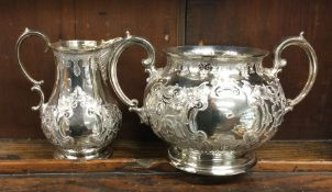 An embossed silver plated sugar bowl together with