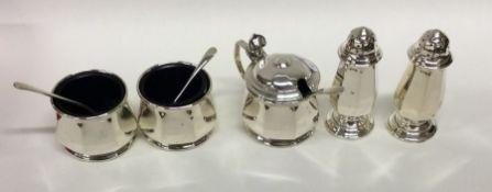 An Edwardian silver five piece cruet set. Birmingh