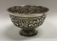 An Edwardian silver pedestal bowl decorated with a