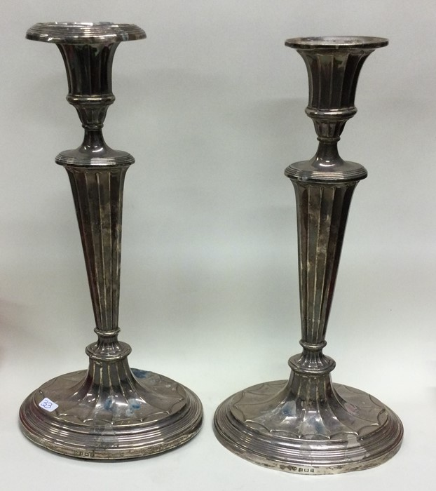 A pair of large tapering silver candlesticks. Birm