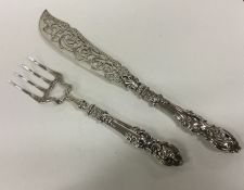 A large pair of silver fish servers with chased ha