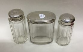 A group of three silver mounted dressing table jar
