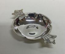 R E STONE: A shaped silver dish of typical form. L