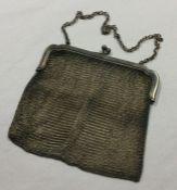 A heavy silver mesh purse. London. Approx. 230 gra
