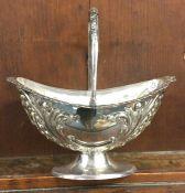 A silver plated sugar basket. Est. £10 - £20.